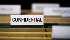 "file folder with ""confidential label in filing cabinet"