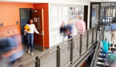busy-high-school-corridor-during-recess-with-blurred-students-and-picture-id976317922