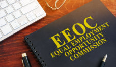 Equal Employment Opportunity Commission EEOC on a desk.